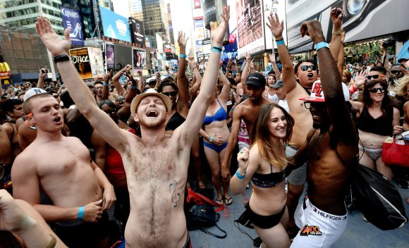 epa03814192 People dance in their underwear during an event billed as National Underwear Day which was hoping to gather a record number of people together in underwear, in Times Square in New York, New York, USA, 05 August 2013. EPA/JUSTIN LANE