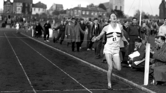 """Bannister.Mile. Times negs 146590 -146596 Sir Roger Gilbert Bannister, CBE (born 23 March 1929) is an English former athlete, doctor and academic, who ran the first sub-four-minute mile. This was finally achieved on 6 May 1954 at Iffley Road Track in Oxford, with Chris Chataway and Chris Brasher providing the pacing. When the announcer declared """"The time was three..."""", the cheers of the crowd drowned-out the details of the result, which was 3 min 59.4 sec. RogerBannisterWorldRecord - Original image used in 1954 as a tight crop on page 8 of The Times on 07/05/54"""